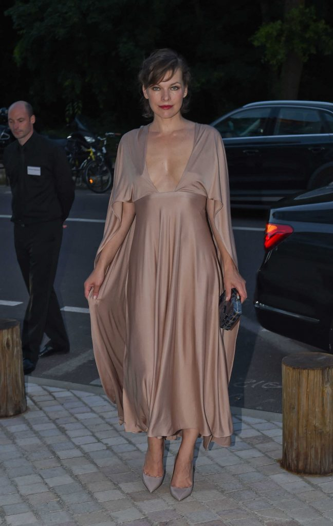 Milla Jovovich at the Art of Giving Love Ball Naked Heart Foundation Photo Call in Paris-1