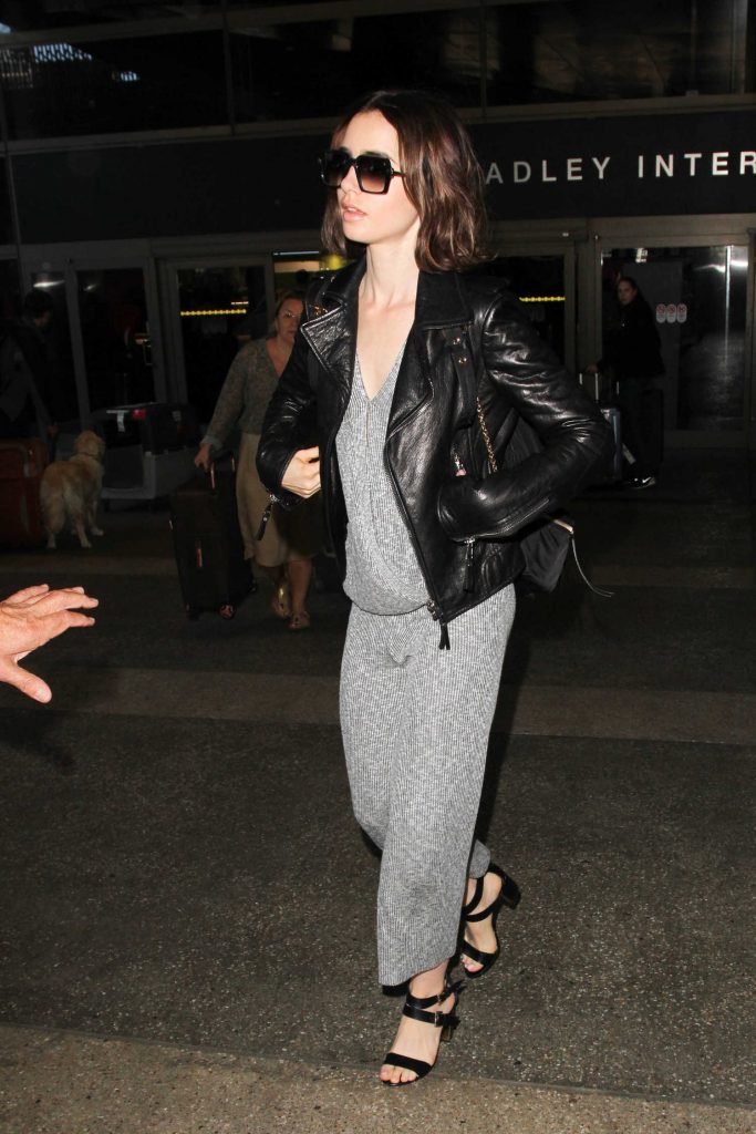 Lily Collins Arrives at LAX Airport in Los Angeles-1