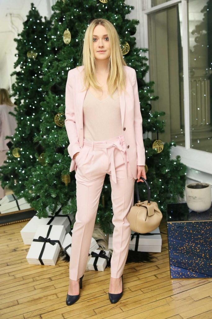 Dakota Fanning Visits a Holiday Celebration at The Line in New York-1