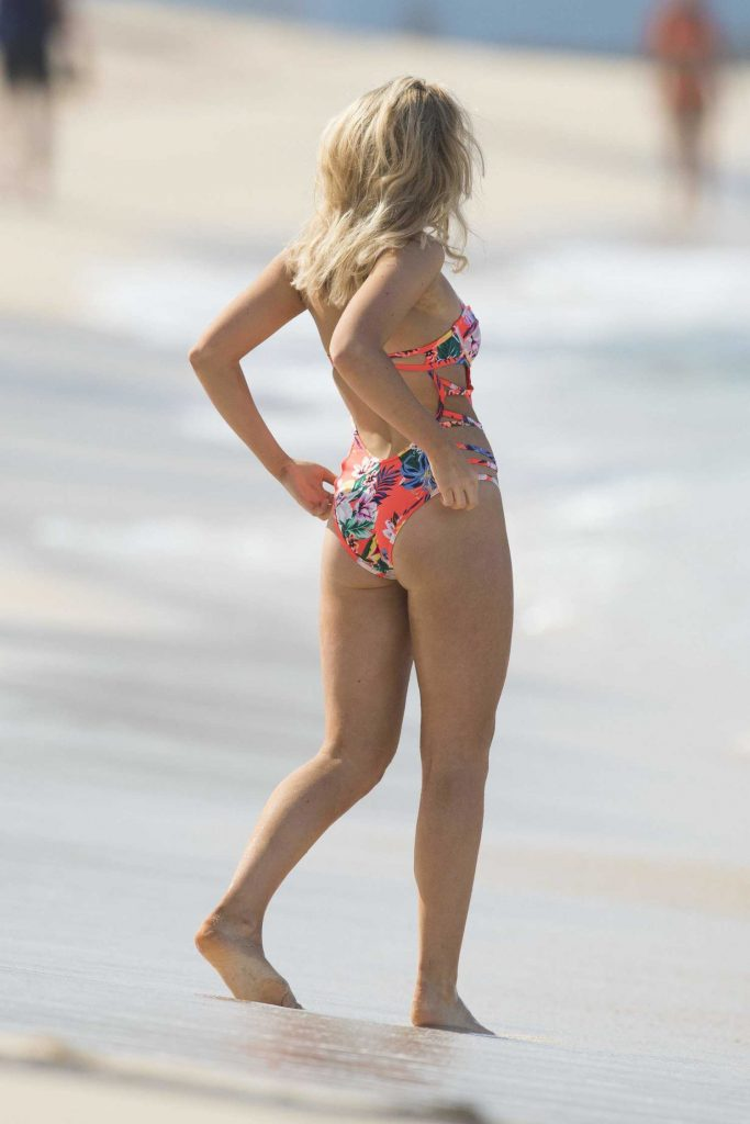 Tallia Storm Wearing a Floral Swimsuit at the Beach in Barbados-3