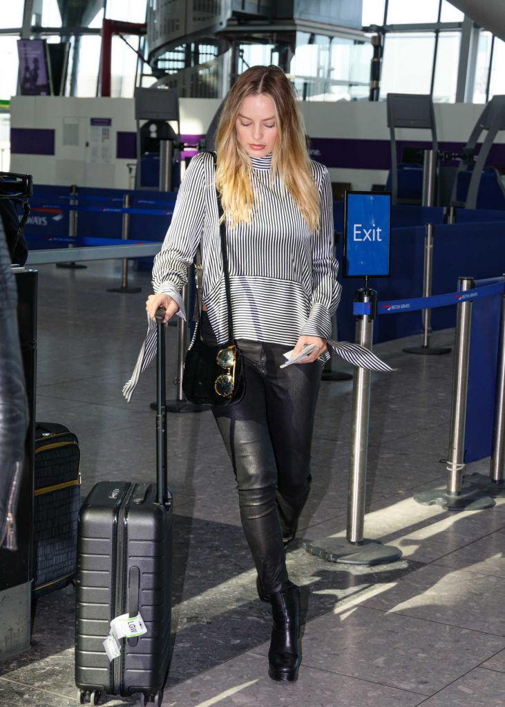 Margot Robbie at Heathrow Airport in London-1