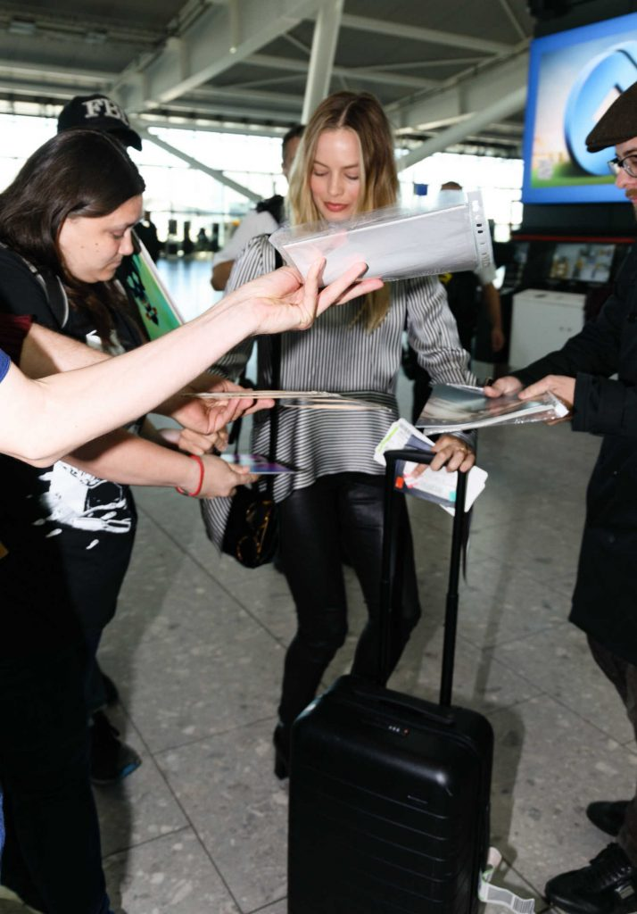 Margot Robbie at Heathrow Airport in London-4