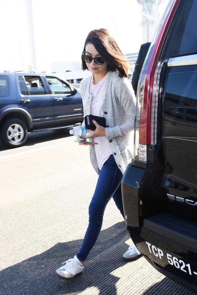 Miranda Cosgrove Arrives at LAX Airport in LA-1