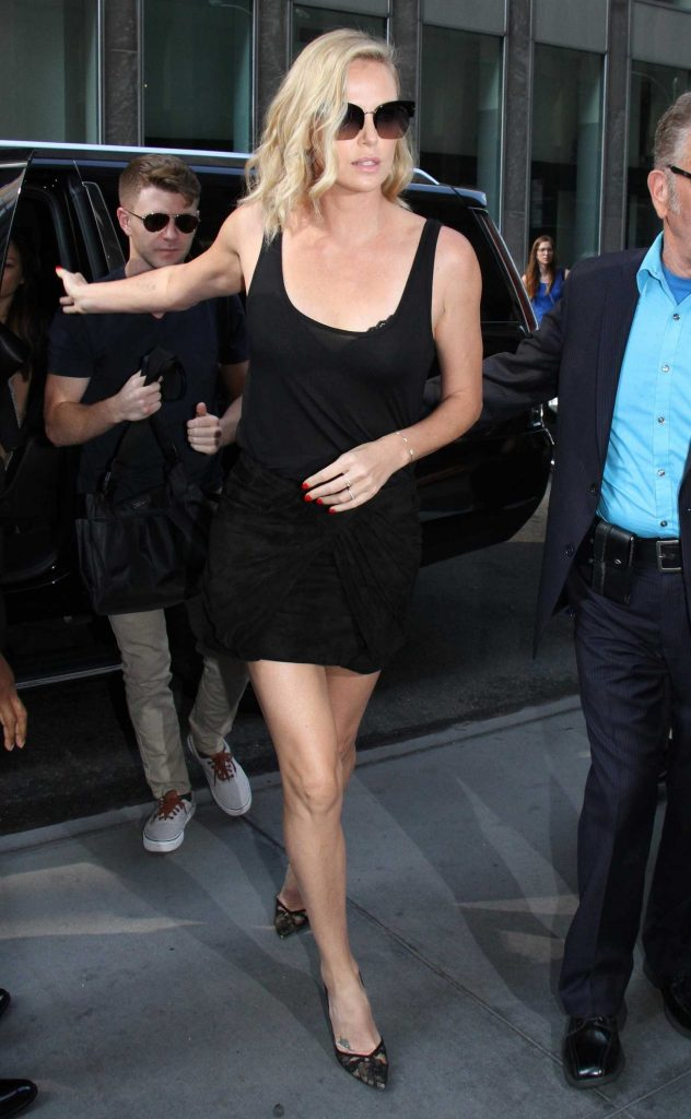Charlize Theron Arrives at The Howard Stern Show in New York City-1