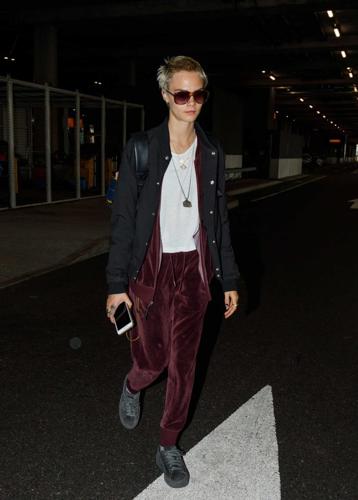 Cara Delevingne Arrives at Heathrow Airport in London-1