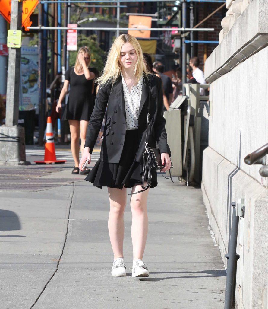 Elle Fanning Shops by Herself in Soho, NYC-1