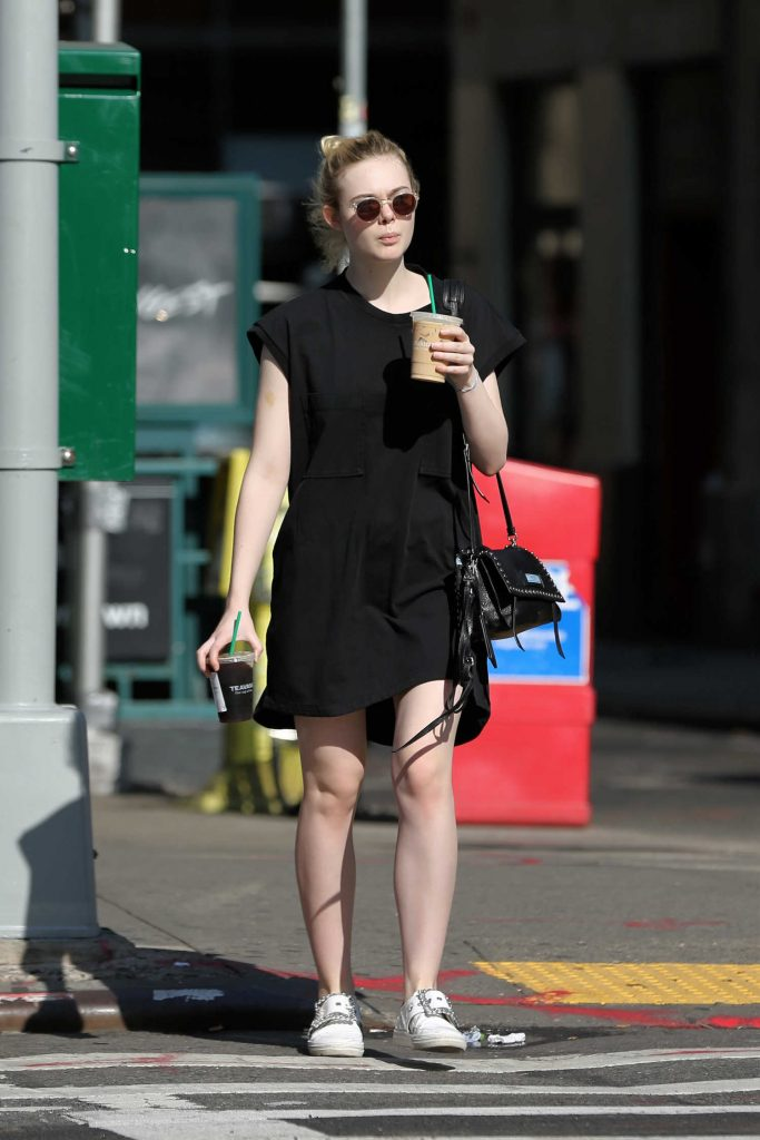 Elle Fanning Walks Home With an Iced Coffee in NYC-1