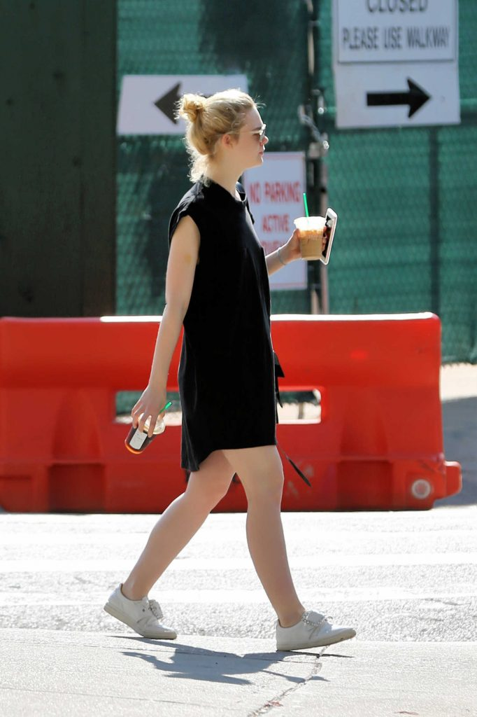 Elle Fanning Walks Home With an Iced Coffee in NYC-4