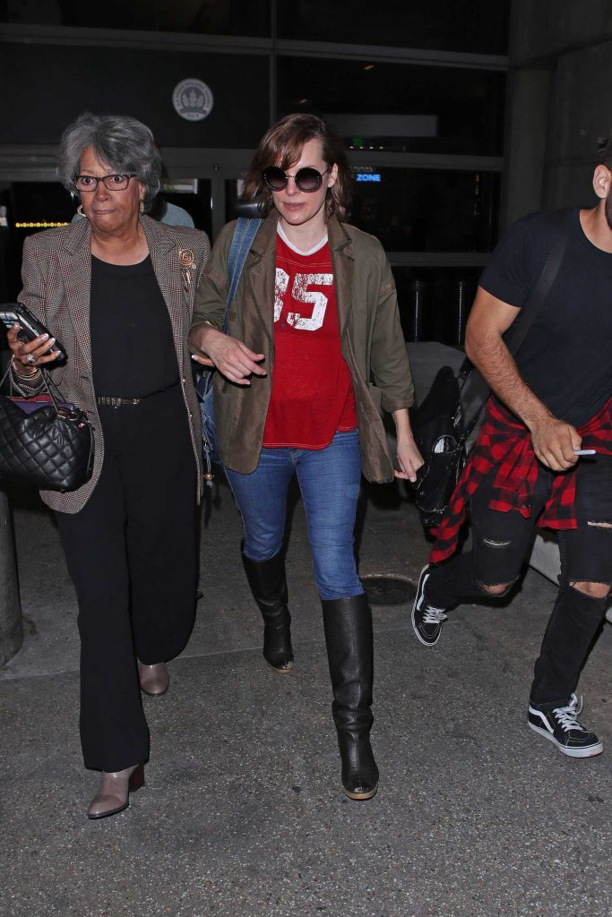 Milla Jovovich Arrives at LAX Airport in Los Angeles-1