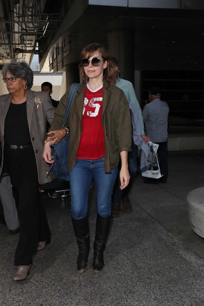 Milla Jovovich Arrives at LAX Airport in Los Angeles-3