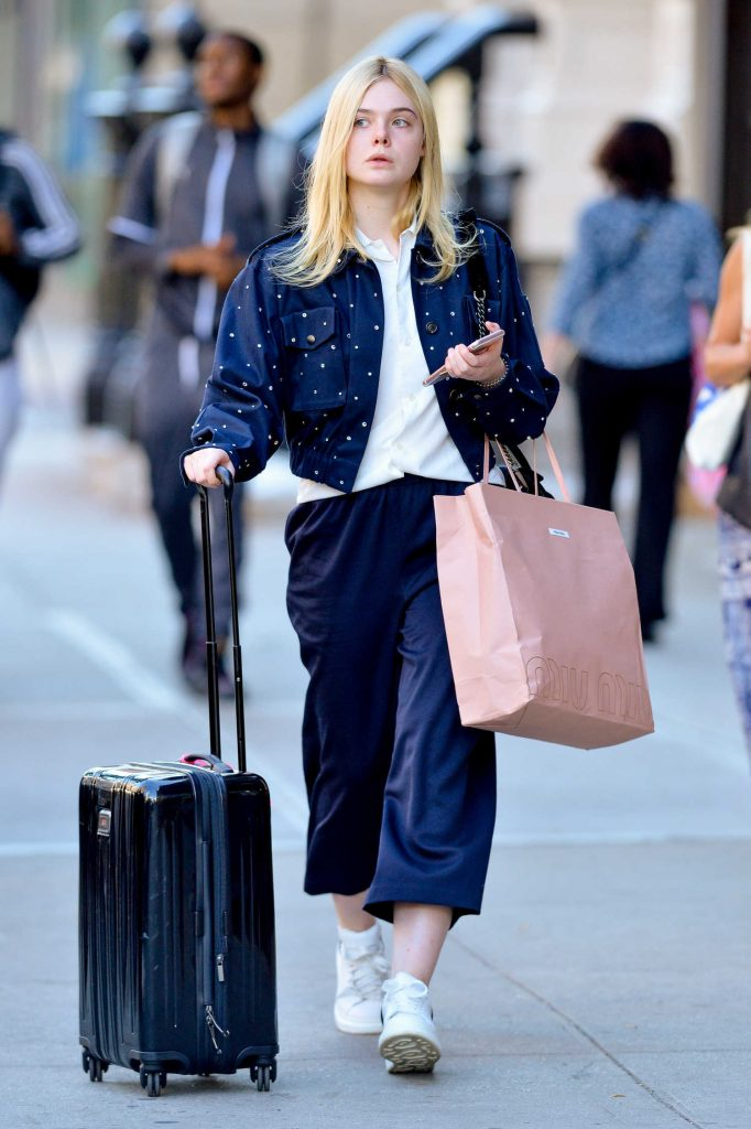 Elle Fanning Pulls Her Suitcase in NYC-1