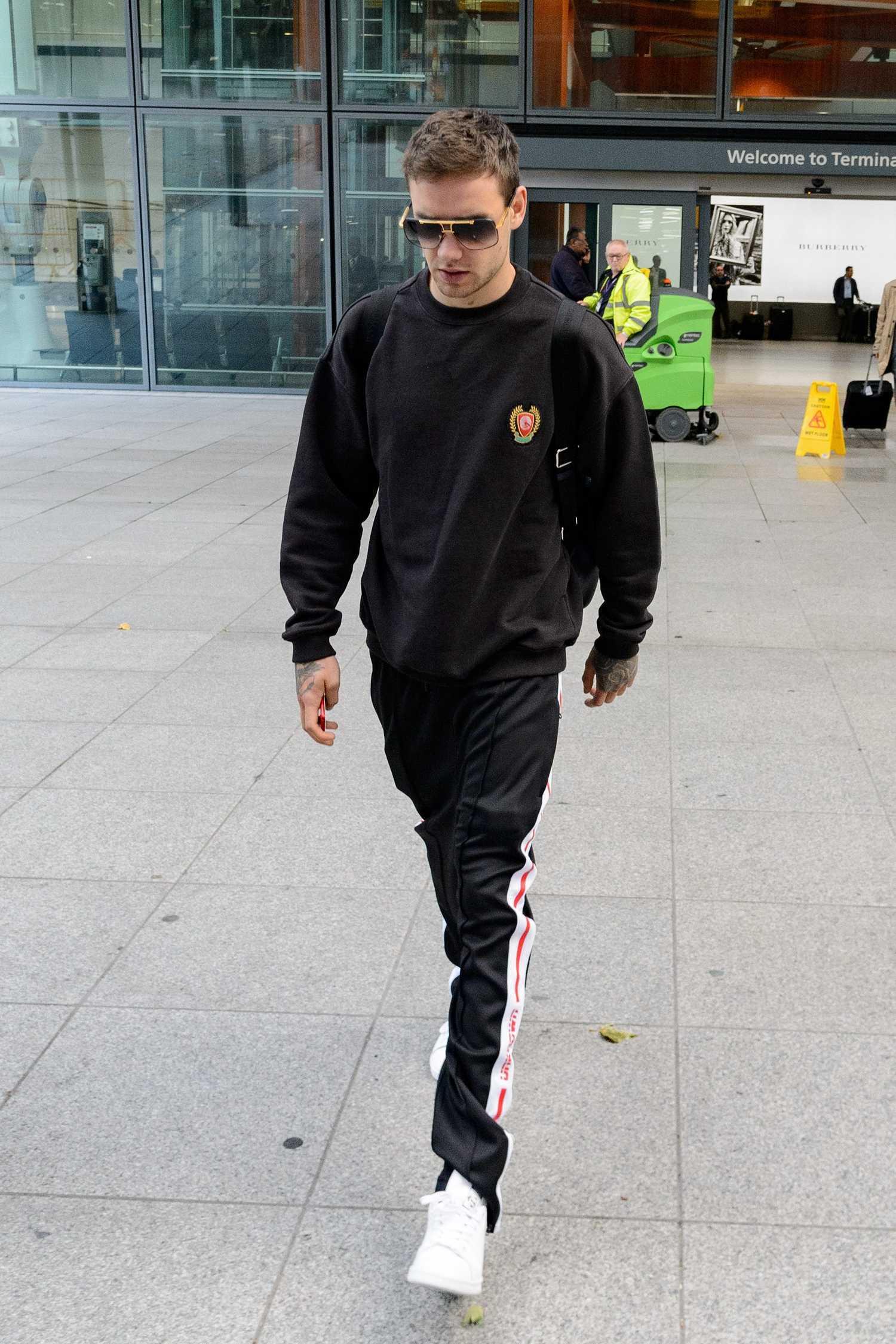 Liam Payne Leaves Heathrow Airport In London Celeb Donut