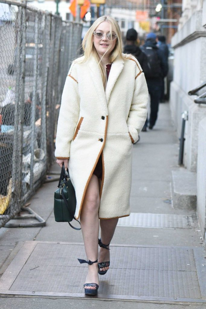 Dakota Fanning Wears a White Coat Out in NYC-1