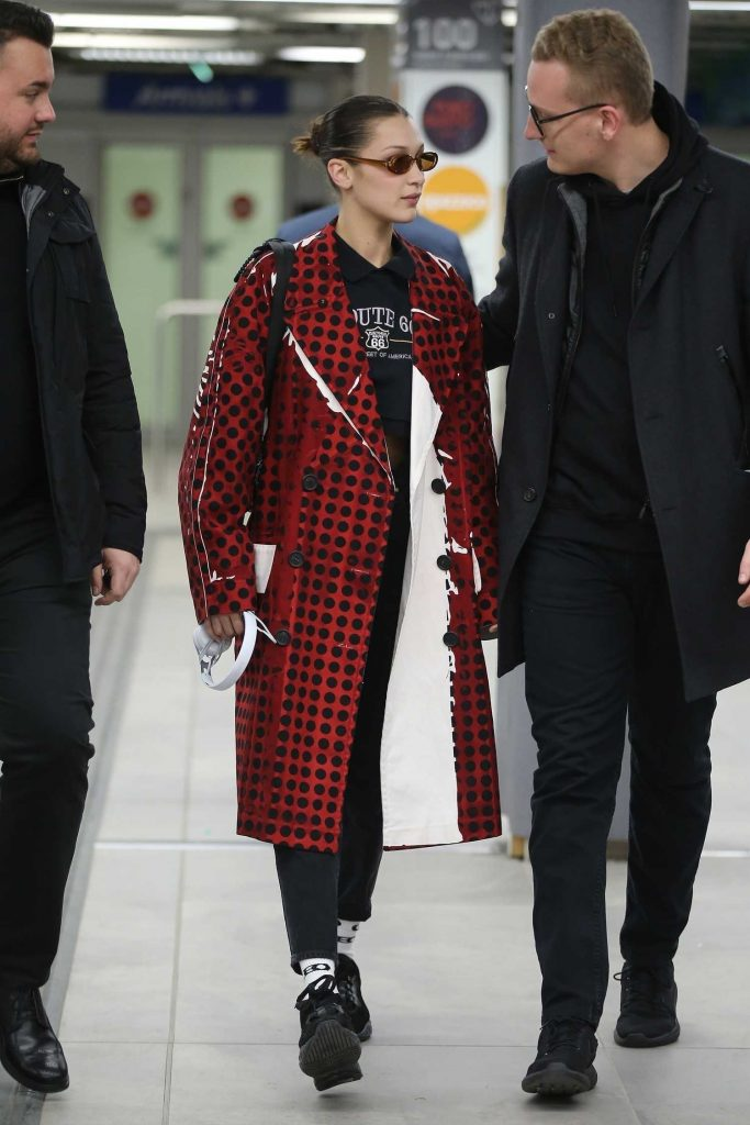 Bella Hadid Wears in a Red Checkered PVC Coat at Milan Airport in Milan-2