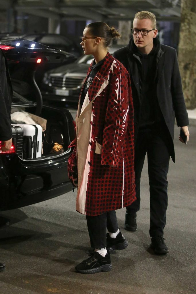 Bella Hadid Wears in a Red Checkered PVC Coat at Milan Airport in Milan-5
