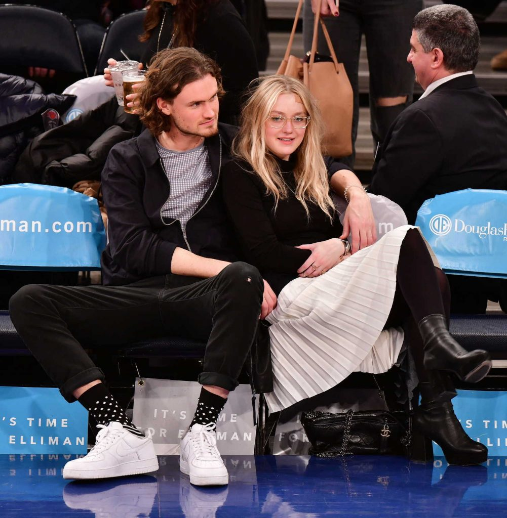 Dakota Fanning at the New York Knicks vs Milwaukee Bucks Game with Henry Frye in NYC-1