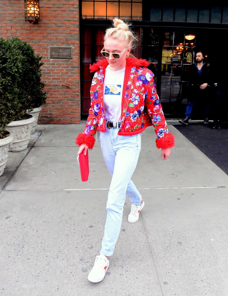 Sophie Turner Wears a Red Flowered Jacket as She Leaves Her Hotel in New York City-3