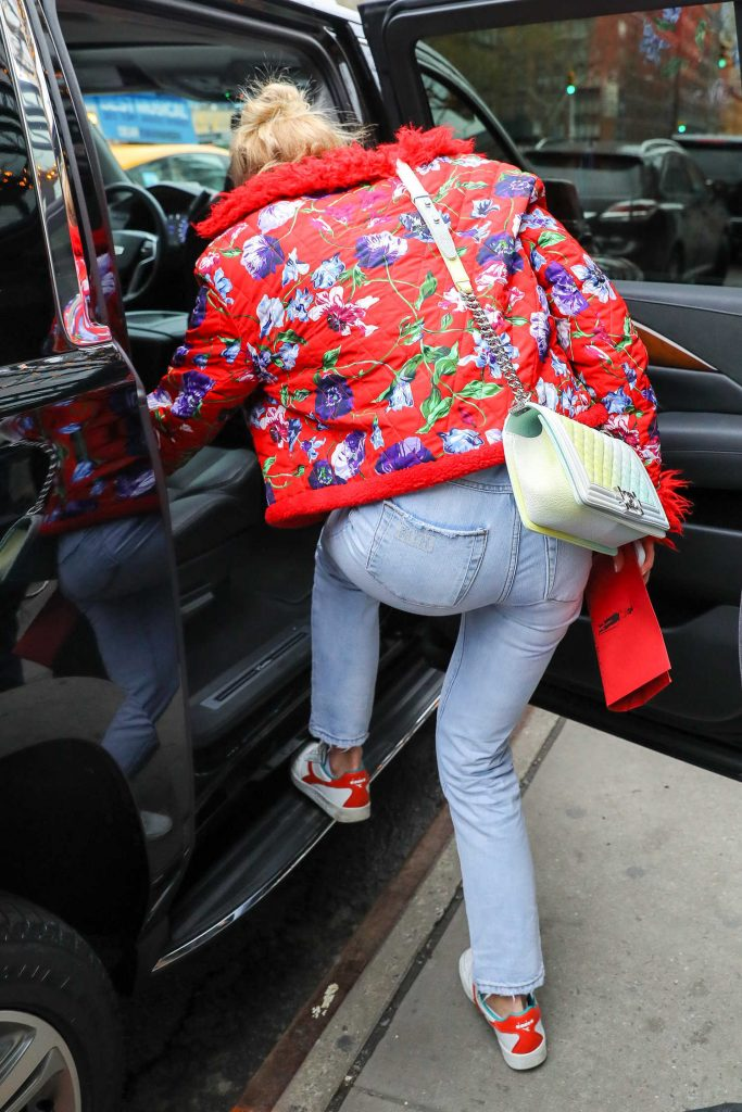 Sophie Turner Wears a Red Flowered Jacket as She Leaves Her Hotel in New York City-5