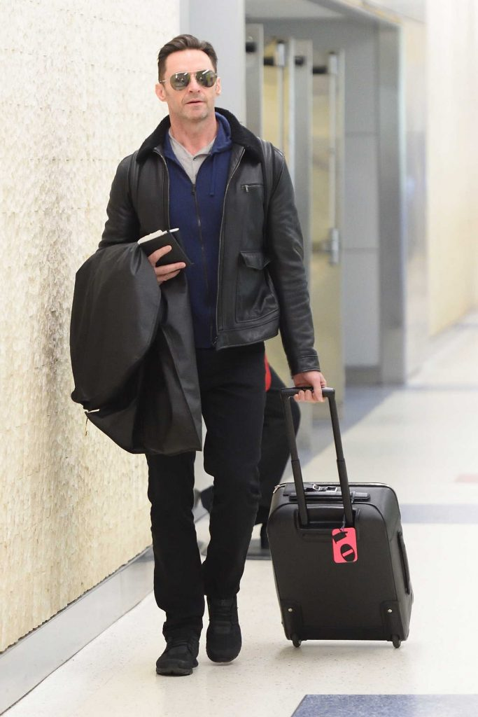 Hugh Jackman Wears a Black Leather Jacket at JFK Airport in NYC-1