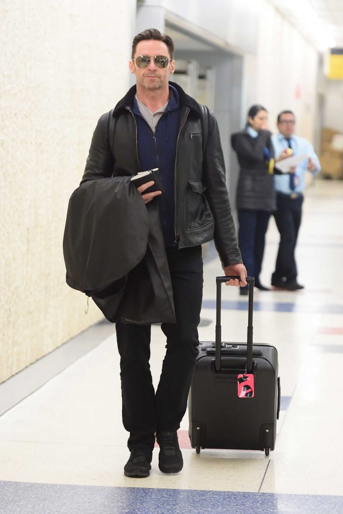 Hugh Jackman Wears a Black Leather Jacket at JFK Airport in NYC-2