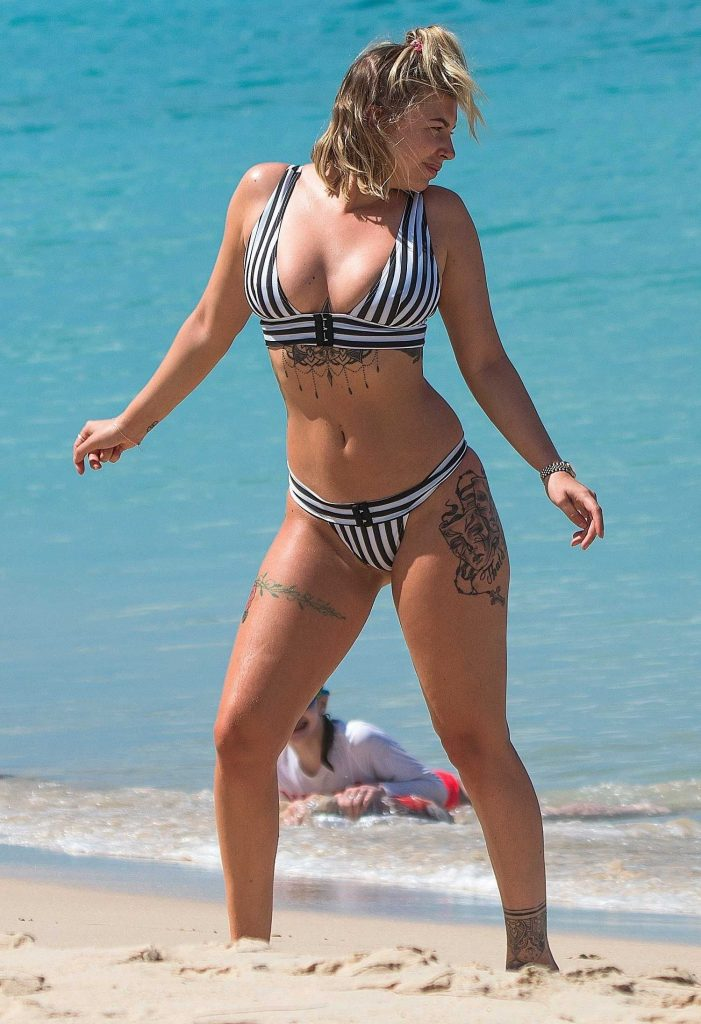 Olivia Buckland Wears a Striped Bikini on the Beach in Barbados-3