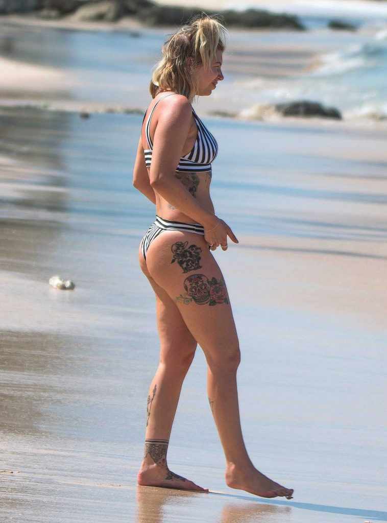Olivia Buckland Wears a Striped Bikini on the Beach in Barbados-4