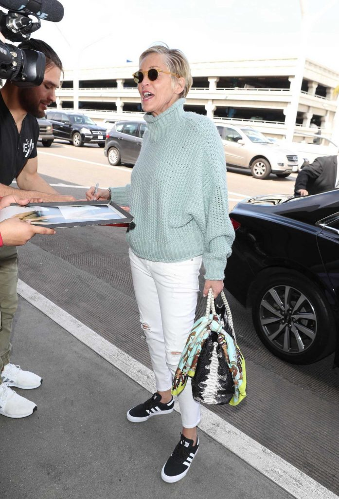 Sharon Stone Signs Autographs at LAX Airport in Los Angeles-4