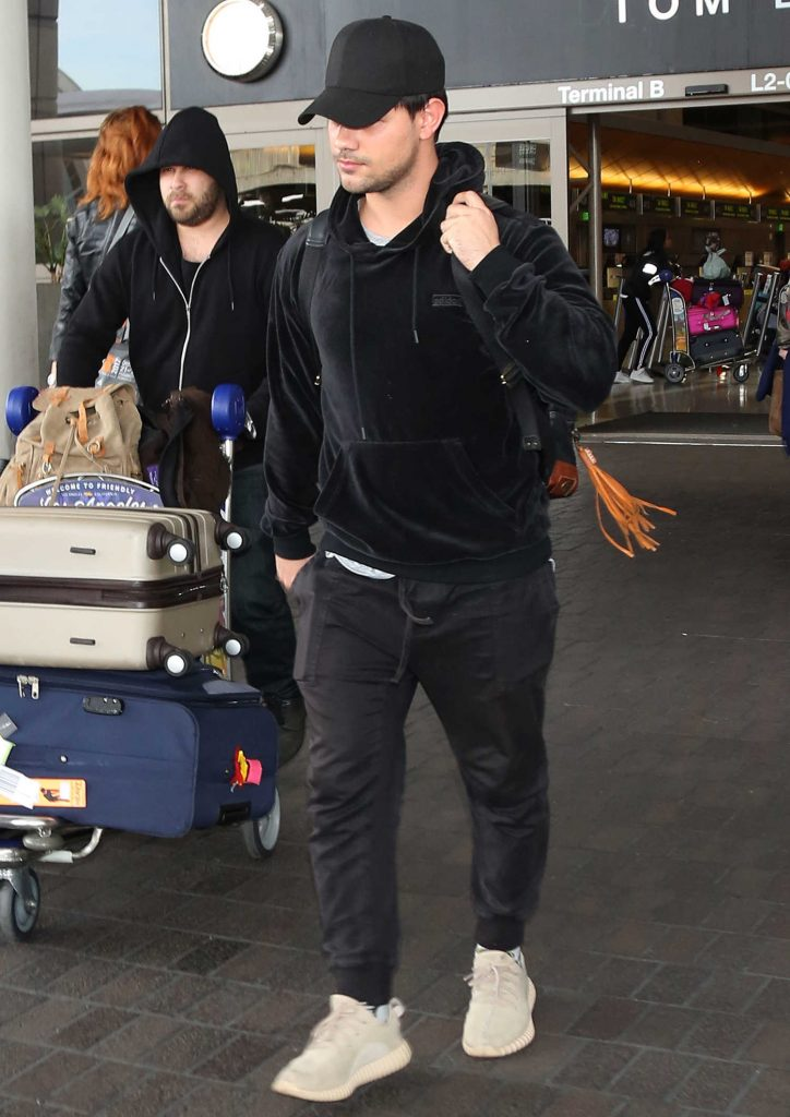 Taylor Lautner Arrives at LAX Airport in LA-1