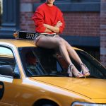 Adriana Lima Poses on the Top of a Taxi Cab During a Photoshoot for Schultz in NYC