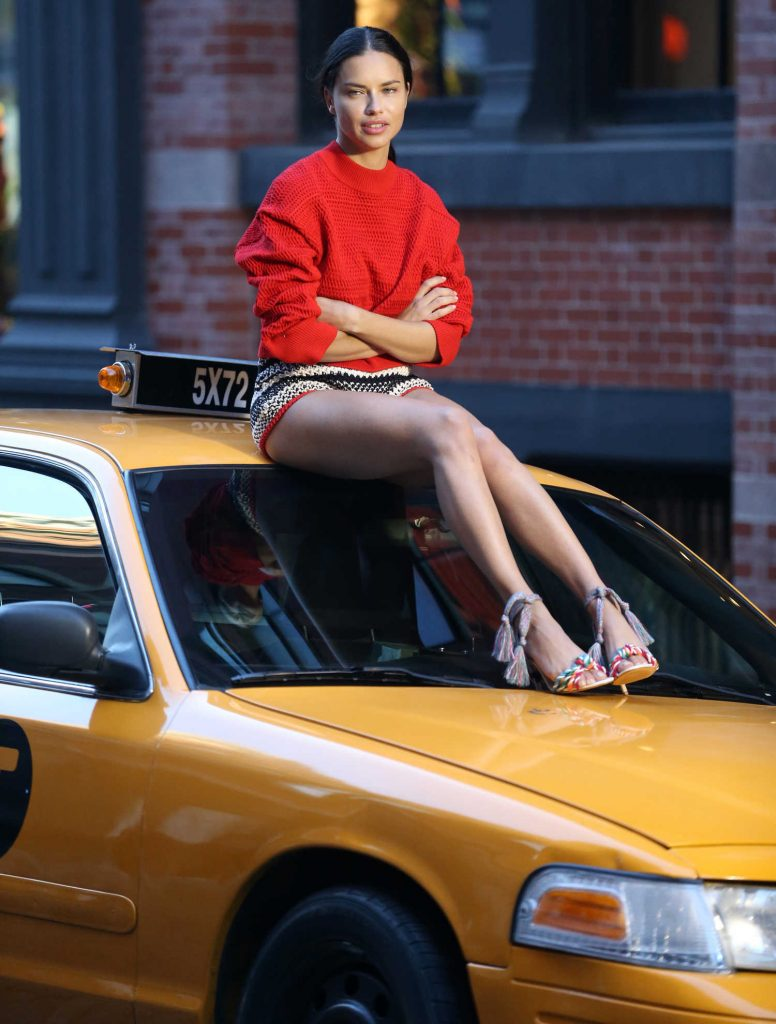 Adriana Lima Poses on the Top of a Taxi Cab During a Photoshoot for Schultz in NYC-1