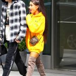 Ariana Grande Wears a Yellow Hoody Out in NYC