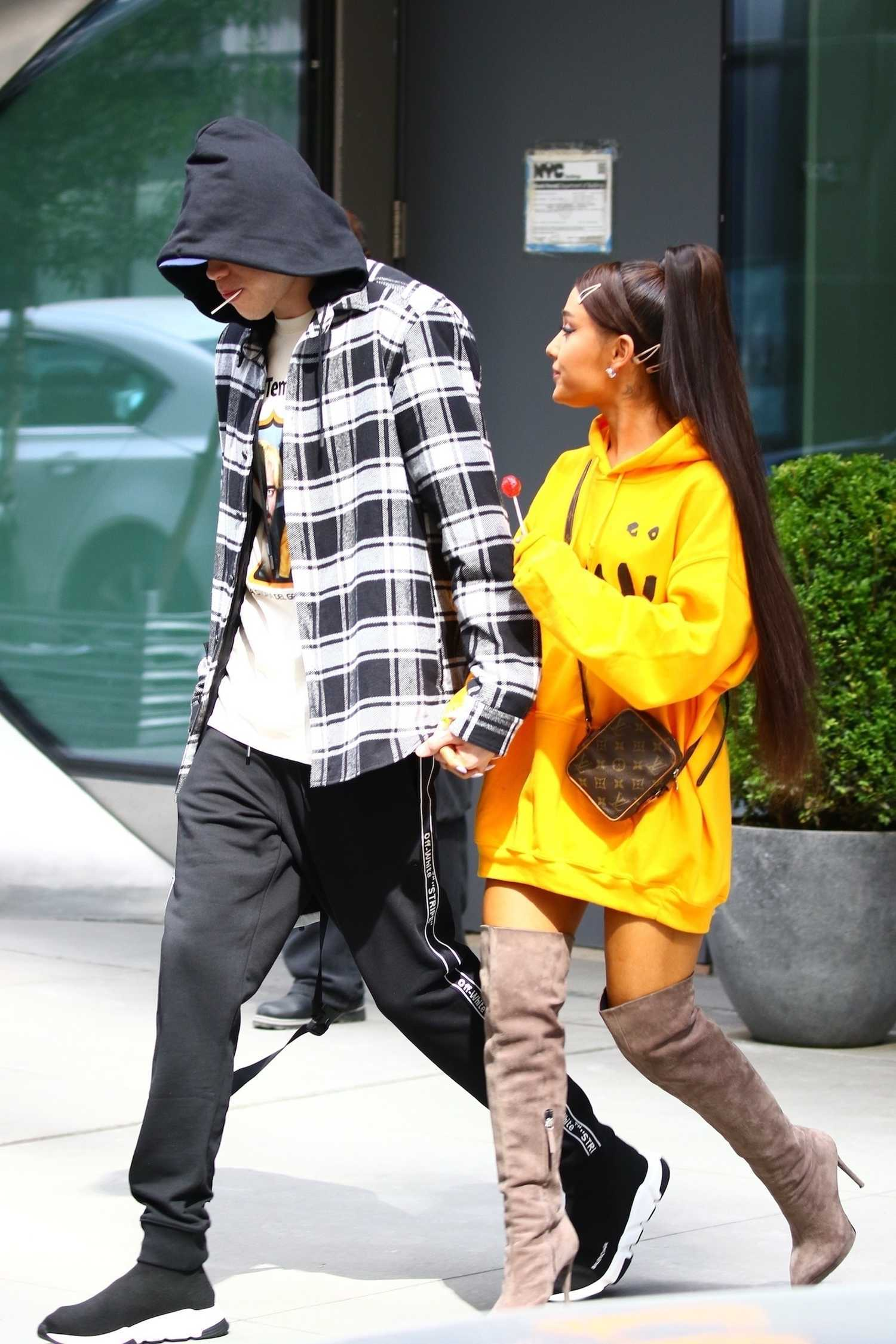 Ariana Grande Wears A Yellow Hoody Out In Nyc Celeb Donut