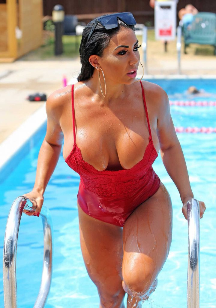 Grace J Teal Wears a Red Baywatch Swimsuit by the Pool in Southend-4