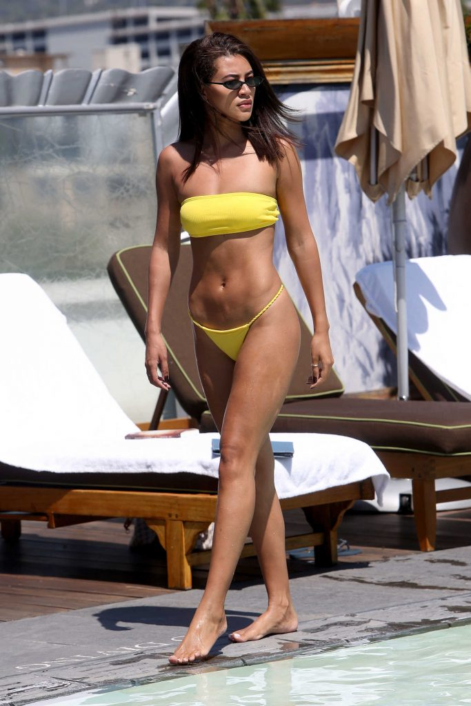 Montana Brown Wears a Yellow Bikini by the Pool in Los Angeles-2
