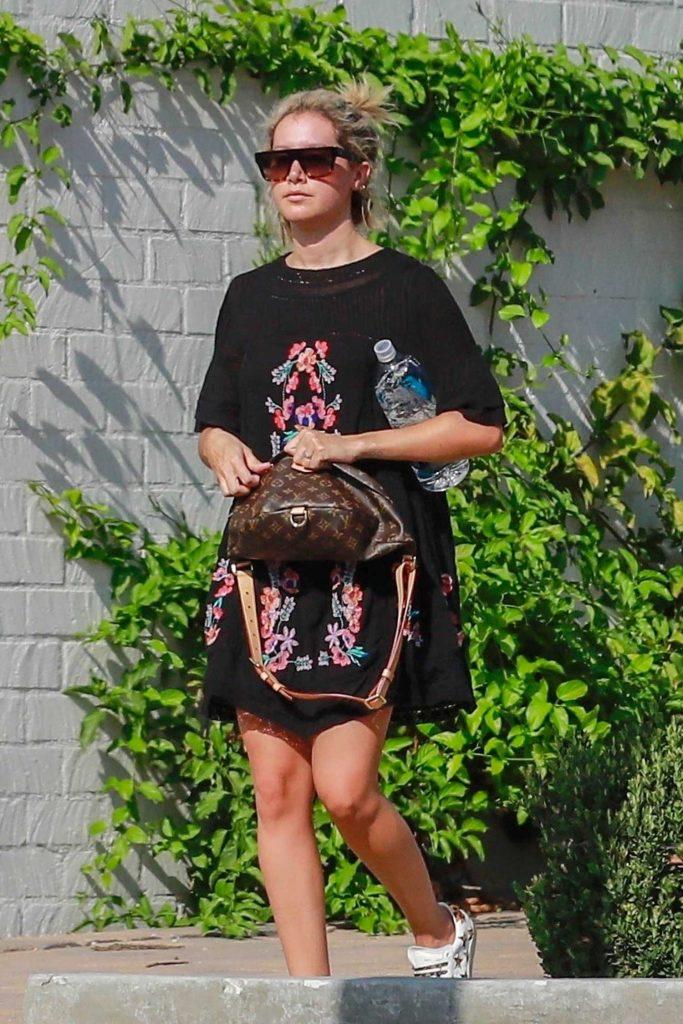 Ashley Tisdale in a Black Floral Dress