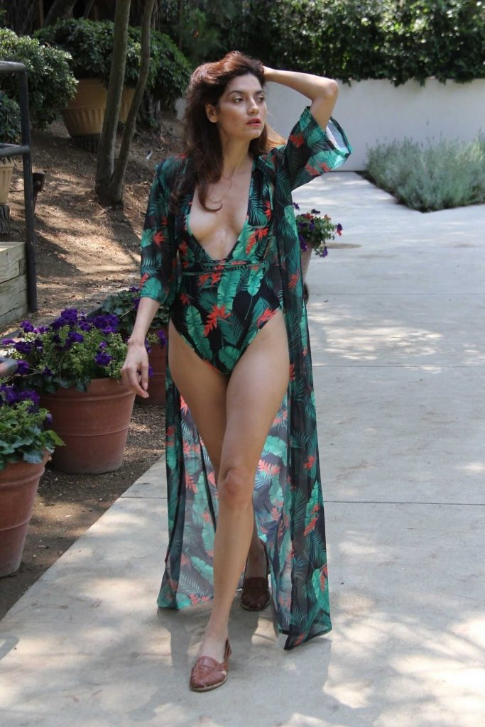 Blanca Blanco in a Green Floral Swimsuit