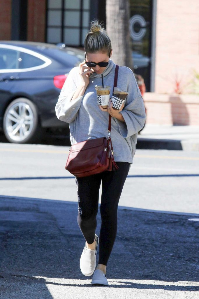 Brittany Snow in a Gray Hoody