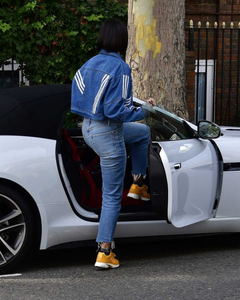 Dua Lipa in a Yellow Adidas Sneakers