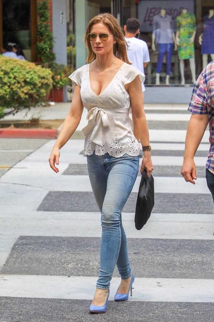 Josie Davis in a Blue Slim Jeans