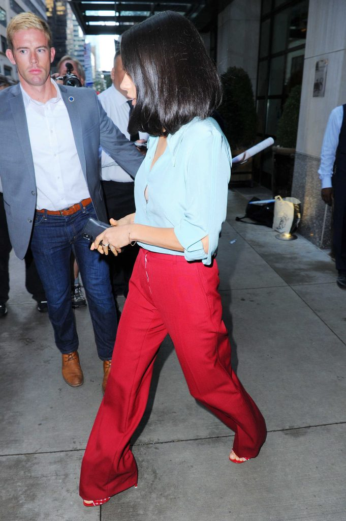 Mila Kunis in a Red Pants