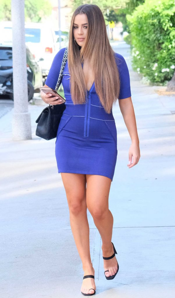 Tessa Brooks in a Short Blue Dress