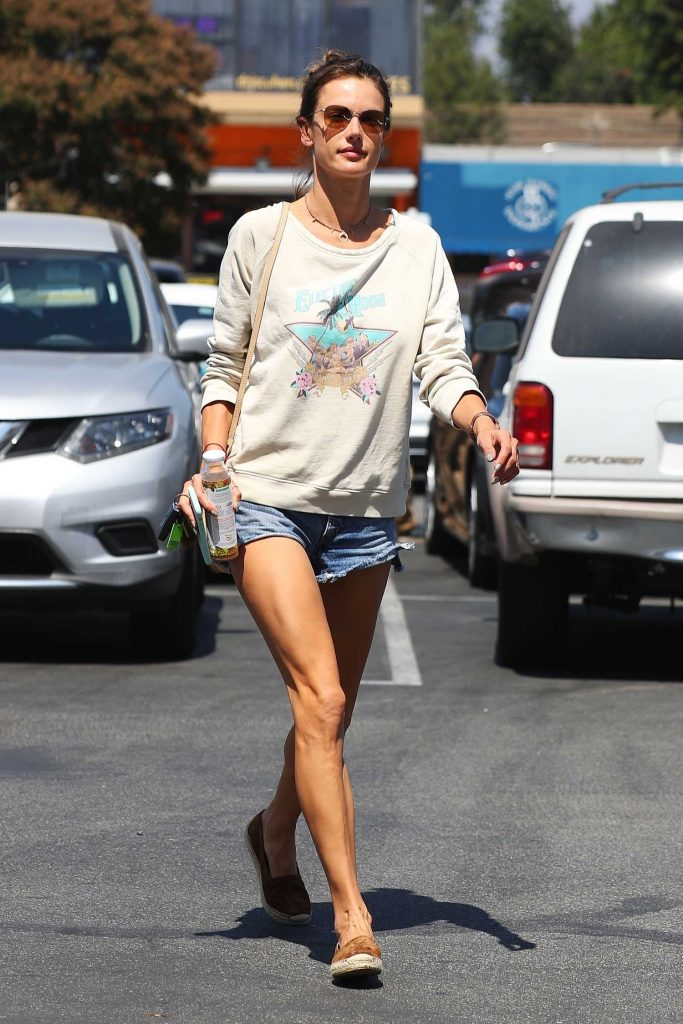 Alessandra Ambrosio in a Riped Denim Shorts