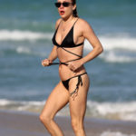 Chloe Sevigny in a Black Bikini on the Beach in Miami