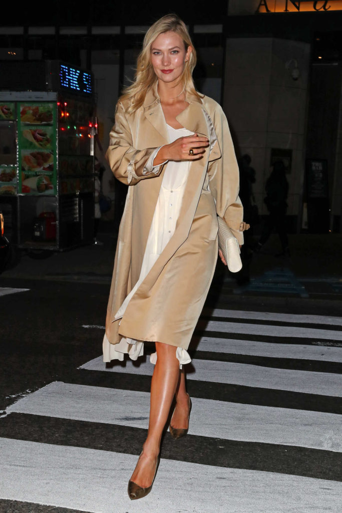Karlie Kloss in a Beige Trench Coat