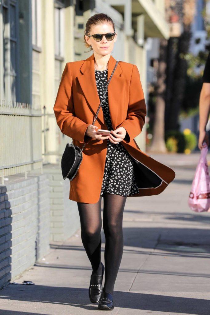Kate Mara in a Long Orange Blazer