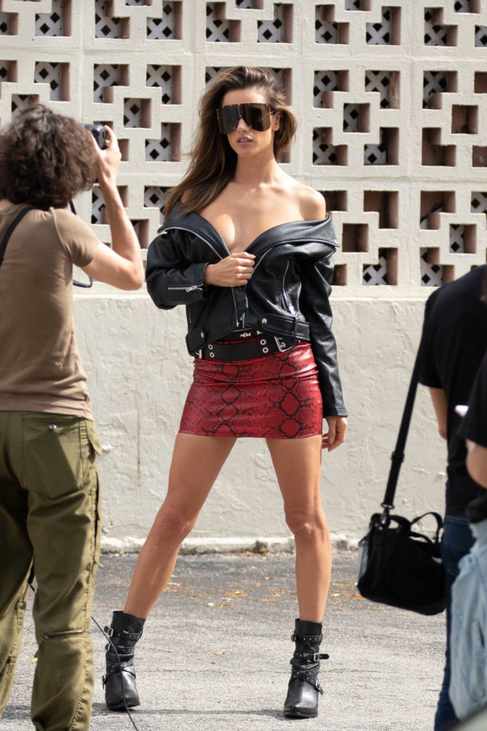 Alessandra Ambrosio in a Short Red Snakeskin Skirt