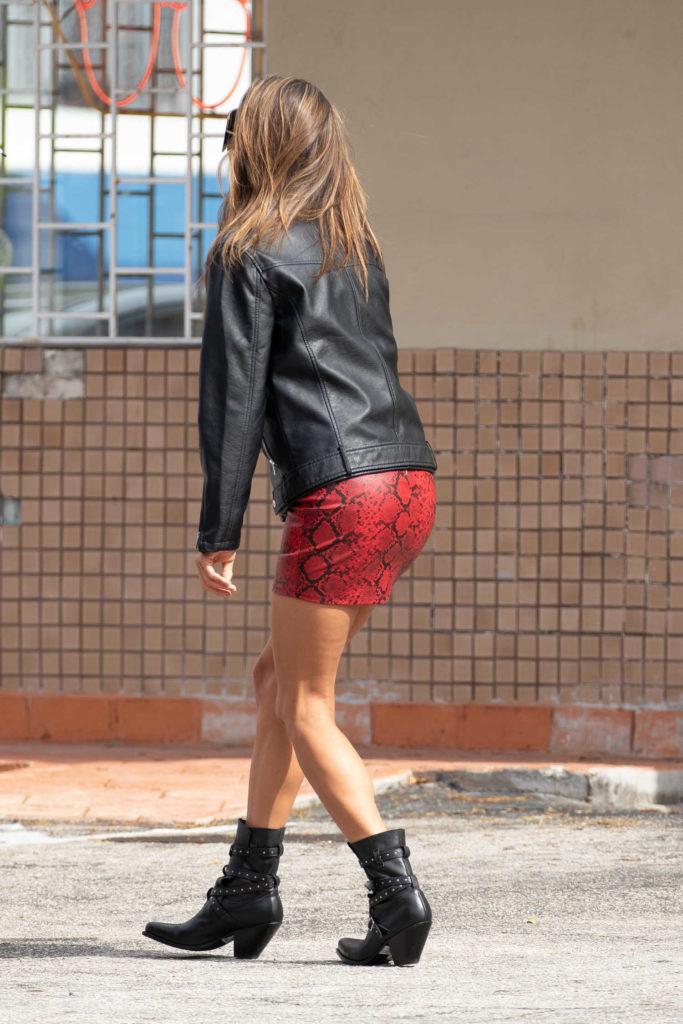 Alessandra Ambrosio in a Short Red Snakeskin Skirt