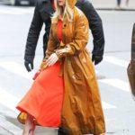 Alice Eve in an Orange Trench Coat Arrives at SiriusXM Studios in New York City