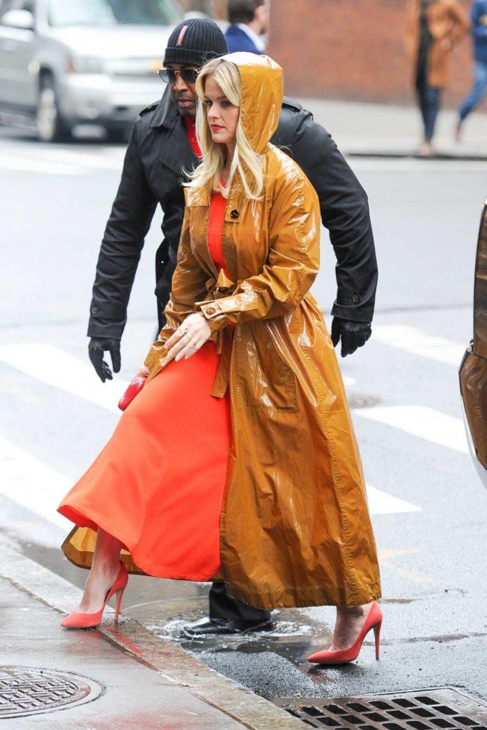 Alice Eve in an Orange Trench Coat