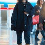 Rihanna in Denim Oversized Shirt Arrives at JFK Airport in New York City